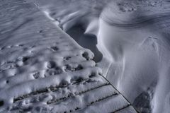 Frozen Lake. A snow covered dock over a frozen lake Stock Photos