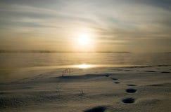 Frozen lake. Frosen lake in winter.Sun reflection in the lake Royalty Free Stock Photos