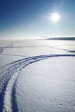 Frozen lake. Sun above frozen lake in winter royalty free stock image