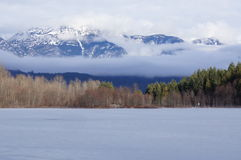 Frozen Lake. In forest and mountain wilderness Stock Photos