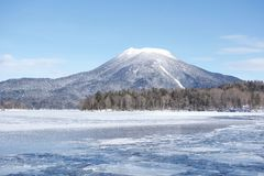 Frozen Lake Akan, Hokkaido. Lake Akan was born from the eruption of a volcano. It is surrounded by Mount Meakan and Mount Oakan royalty free stock image