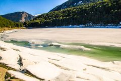 Frozen Lake in Andorra with blue sky stock photography