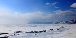 Frozen Lake Baikal. In spring. Day Stock Photos