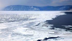 Frozen Lake Baikal. Spring. Day. Mountains on horizon Royalty Free Stock Photos