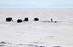 Frozen Lake Baikal. In winter. Fishing. Day Stock Photo