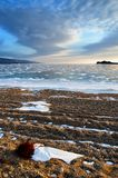 Frozen Lake Baikal. Beautiful stratus clouds over the ice surface on a frosty day. Natural background stock image