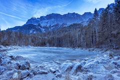 Frozen lake in the bavarian Alps Royalty Free Stock Images
