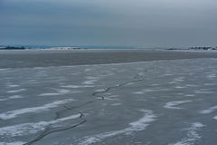 Frozen Lake. Beautiful stratus clouds over the ice surface on a frosty day. Natural background Stock Photography