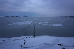 Frozen Lake. Beautiful stratus clouds over the ice surface on a frosty day. Natural background Royalty Free Stock Photos
