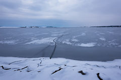 Frozen Lake. Beautiful stratus clouds over the ice surface on a frosty day. Natural background Stock Image
