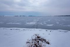 Frozen Lake. Beautiful stratus clouds over the ice surface on a frosty day. Natural background Royalty Free Stock Photography
