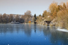 Frozen lake with blue ice Stock Photos
