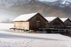 Frozen lake boathouse Stock Image