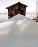 Frozen lake boathouse Royalty Free Stock Images