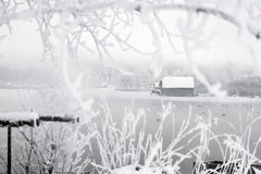 Frozen lake boathouse Royalty Free Stock Photography