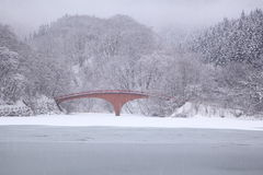 Frozen lake and bridge Stock Photo