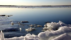 Frozen lake with white snow. Frozen lake with calm still water white snow on the shore Royalty Free Stock Images