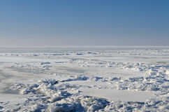 Frozen lake with crushed ice sheet Stock Photo