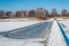 Frozen lake in a Dutch nature area Stock Images