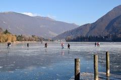 The frozen lake Endine in the Bergamo area - Italy. Sunday, January 8, 2017-Lake Endine-Bergamo-Lombardia-Italy-A crowd of unidentified people enjoy walking on royalty free stock image