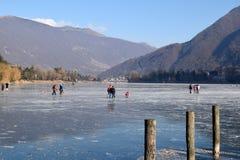 The frozen lake Endine in the Bergamo area - Italy. Sunday, January 8, 2017-Lake Endine-Bergamo-Lombardia-Italy-A crowd of unidentified people enjoy walking on stock photos