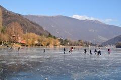 The frozen lake Endine in the Bergamo area - Italy. Sunday, January 8, 2017-Lake Endine-Bergamo-Lombardia-Italy-A crowd of unidentified people enjoy walking on stock image