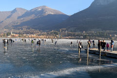The frozen lake Endine in the Bergamo area - Italy. Sunday, January 8, 2017-Lake Endine-Bergamo-Lombardia-Italy-A crowd of unidentified people enjoy walking on royalty free stock photography