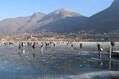 The frozen lake Endine in the Bergamo area - Italy. Sunday, January 8, 2017-Lake Endine-Bergamo-Lombardia-Italy-A crowd of unidentified people enjoy walking on stock photo