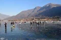 The frozen lake Endine in the Bergamo area - Italy. Sunday, January 8, 2017-Lake Endine-Bergamo-Lombardia-Italy-A crowd of unidentified people enjoy walking on stock images