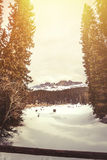 Frozen lake, fir forest and mountains. Lake Carezza in South Tyrol in Italy. stock photos