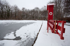 Frozen lake with first aid station Stock Images