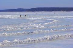 Frozen lake and fishermen Stock Photo