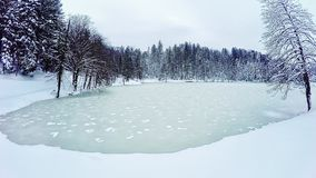 Frozen lake. Gopro 4 quadcopter aerial view of the frozen lake near the castle Trakoscan in Croatia stock footage
