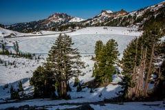 Frozen Lake Helen in Spring, Lassen National Park` Royalty Free Stock Images