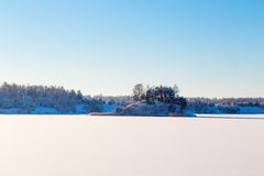 Frozen lake with ice and snow Stock Images
