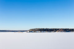 Frozen lake with ice and snow Stock Photos
