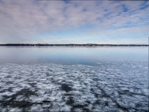 Frozen Lake Land In Winter. Frozen Marsh Land In Winter with blue sky and clouds cattails wetlands Stock Images