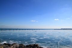 Frozen Lake Michigan with icy rocks and view of Chicago Skyline Stock Photo