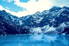 Frozen lake Morskie oko with mountain landscape Stock Images