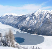 Frozen lake with mountain backdrop. Frozen lake Achensee in Austria with mountain backdrop Stock Images