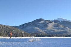 Frozen lake, mountain background stock image