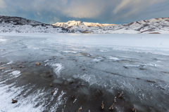 Frozen Lake with mountains. Frozen Deer Creek Reservoir with Mt. Timpanogos in the back ground Royalty Free Stock Photo