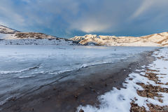 Frozen Lake with mountains. Frozen Deer Creek Reservoir with Mt. Timpanogos in the back ground Stock Photos
