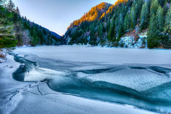 Frozen lake in the mountains Royalty Free Stock Image
