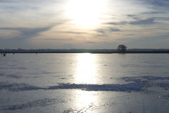 Frozen lake in the netherlands stock photo