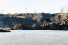 Frozen lake with one house in a mountain land Royalty Free Stock Photos