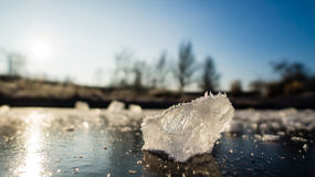 Frozen lake. Frozen pieces of ice on a small frozen lake Stock Photo