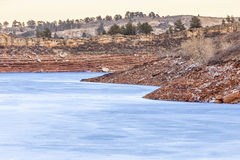 Frozen lake with red cliffs Stock Photos