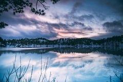 Frozen lake reflections stock photography