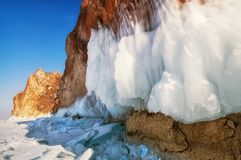 Frozen lake and rocks near the ice cave. With colorful sky stock photos